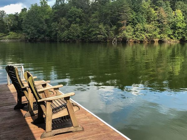 Chairs on the dock at a Smith Mountain Lake cabin