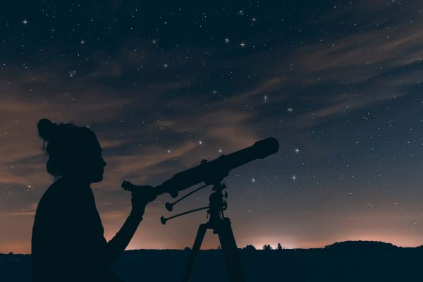 Star gazing at the night sky with a telescope